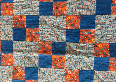 Sheryl Kucker – Brandon, SD, Washers & Bolts, Pieced & machine quilted, 39x41, Blue & red