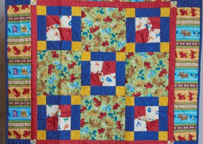 Shetek Camp Quilters – Diane, Holly, Linda & Pat - Sioux Falls SD Name – Red Rover 31x31 Pieced and Machine Quilted Primary colors