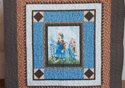 Shetek Camp Quilters – Diane, Holly, Linda & Pat - Sioux Falls SD Name – Let's Go Fly a Kite 41 ½ x 44 Pieced and Machine Quilted Colors – browns & blues