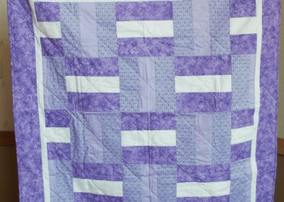 Shetek Camp Quilters – Diane, Holly, Linda & Pat - Sioux Falls SD Name – Purple Galore 46x48 Pieced and Machine Quilted Colors – purple and white