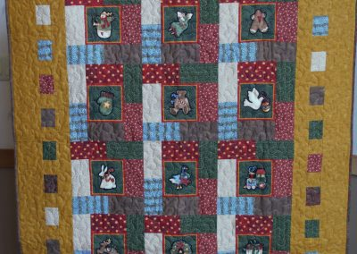 Shetek Camp Quilters – Diane, Holly, Linda & Pat - Sioux Falls SD Name - Framed Ornaments 46x56 Pieced and Machine Quilted Colors – Gold, Red, Green and Blue