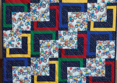 Shetek Camp Quilters – Diane, Holly, Linda & Pat - Sioux Falls SD Name - Bicycle Built for Two 37x45 Pieced and Machine Quilted Colors – Primary Colors