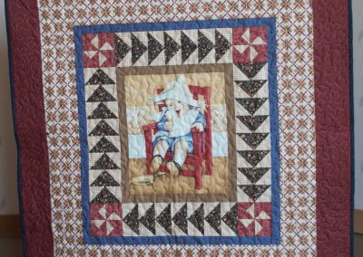 Shetek Camp Quilters – Diane, Holly, Linda & Pat - Sioux Falls SD Name - I Scream for Ice Cream 40 ½ x43 ½  Pieced and Machine Quilted Colors – Red, Blue and Earth Tones
