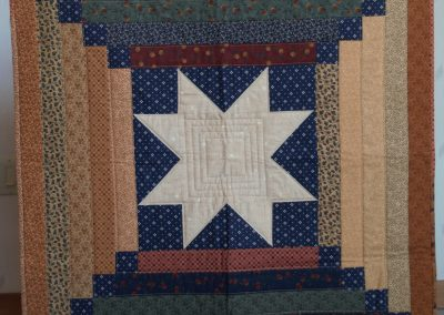 Shetek Camp Quilters – Diane, Holly, Linda & Pat - Sioux Falls SD Name - Star Court House Step Topper 36x36 Pieced and Machine Quilted Colors – Thimble Berries