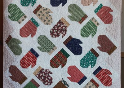 Shetek Camp Quilters – Diane, Holly, Linda & Pat - Sioux Falls SD Name - Mittens 68 ½ x 86  Pieced and Machine Quilted Color - Green, Red, White with Blue Border