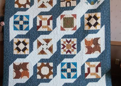 Shetek Camp Quilters – Diane, Holly, Linda & Pat - Sioux Falls SD Name - Main Street Sampler 62 x 77 Pieced and Machine Quilted Colors - Earth Tones