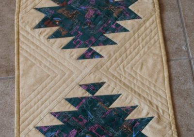 Shetek Camp Quilters – Diane, Holly, Linda & Pat - Sioux Falls SD Name – Table Runner 15 x 55 Pieced and Machine Quilted Colors – Green sewing print set in light Gold background