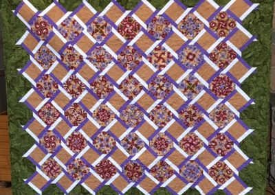 Diane, Holly, Linda & Pat – SF SD, Garden Lattice, Pieced & machine quilted, Floral with green, tans, purple & white accent