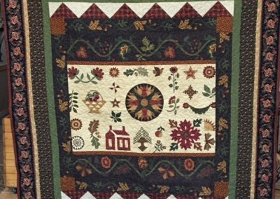 Diane, Holly, Linda & Pat – SF SD, Thimble berries fall leaves and vines, Pieced & machine quilted, 74x81½, Earth tones, greens, browns & red