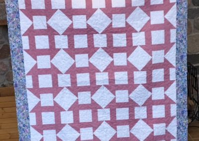 Eastside Lutheran Church- SF SD, Churn Dash, Pieced & machine quilted, 64x78, pink churn dash with blue
