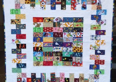 Diane, Holly, Linda & Pat – SF SD, I Spy, Pieced & machine Quilted, 44 x 44, White with Bright's