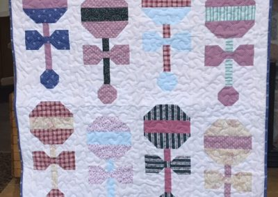 Diane, Holly, Linda & Pat – SF SD, Princess Rattle, Pieced & machine Quilted, 38 1/2x 42 ½, blues, pink, greens