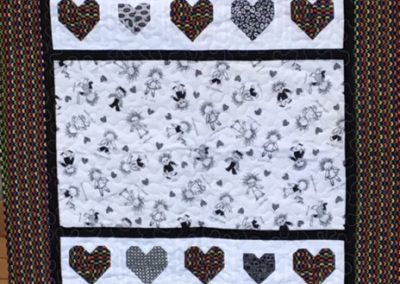Diane, Holly, Linda & Pat – SF SD, Heart of the family, Pieced & machine quilted, 37x51, black & white with brite & black hearts and border