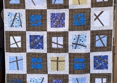 Diane, Holly, Linda & Pat – SF SD, Pickup sticks, Pieced & machine quilted, 62x86, winter blues, snowflakes with brown sashing