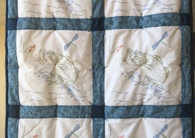 Lake Sarah quilters –Slayton MN, Here fishy, Tied & pieced, 61x42 blue & white, Embroidery by Mary Jean Malmquist