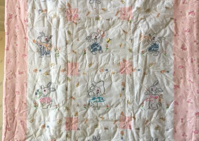 Lucille Magnus- Avoca MN, Bunnies, Hand quilted & embroidered, 40x54 pink & white