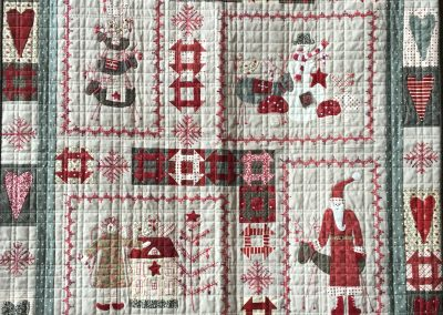 Lynn Larsen – Billings MT Name - Scandinavian Winter 35x54 Pieced, Appliqued and Machine Quilted Colors – red, tan, grey
