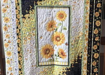 Lynn Larsen – Billings MT Name - Follow the sun 74x92 Pieced and Machine quilted Colors – yellow, black, and white