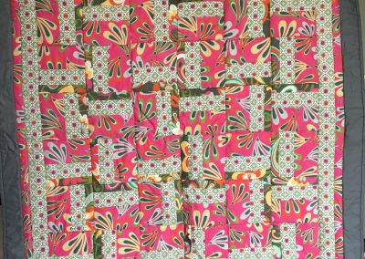 Dana Isaacson – Shetek Name – Baby quilt, pillow & matching mini quilt 40x52 Pieced and machine quilted  Colors – Hot pink, grey & white