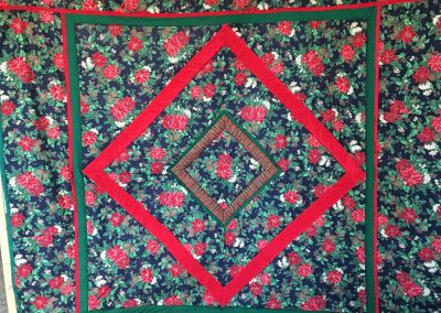 Anonymous Name - Christmas wishes 88x88 Pieced and Machine quilted.  Matching bed skirt with 2 pillow shams Color - red and green