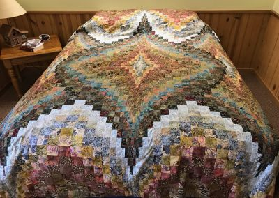 Shetek Grateful Quilters Name – Starburst 90x108  Pieced and machine quilted Colors – Earth tones