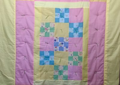 Springtime Flowers – 65x77 – Tied – Pastel Checkered w/yellow back- Made by Our Saviors Lutheran Quilters – Dovray, MN
