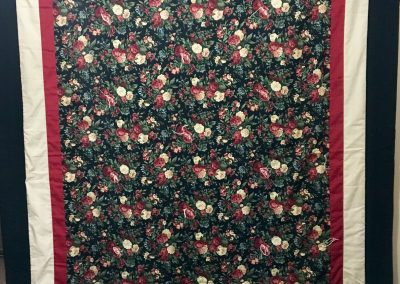 Black Beauty – 63x87 – Tied – Burgundy & Tan, black Floral w/black back – Made by Our Savior's quilters – Dovray, MN