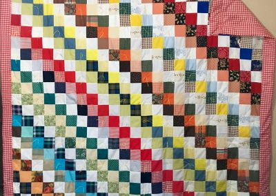 Vintage Square – 66x71 – Tied – Multi colored Squares w/red Checkered Back – Made by Our Saviors quilters – Dovray, MN