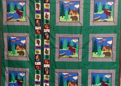 Cabin in the Woods – 60x80 – brown & green w/ brown back – Made by Zion Evangelical Lutheran quilters – Garretson, SD