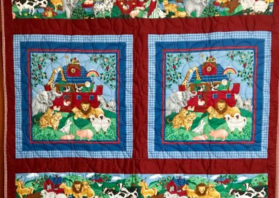 NOAHS ARK – 38x33 – Machine quilted by Vicki Hanson – Cranberry/blue – Made by Janna Milbradt  - Slayton, MN