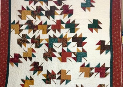 Tumbling Leaves – 50x62 – Brown, green & gold w/white back – Pieced & machine quilted – Made by Shetek Grateful Threads – Slayton, MN
