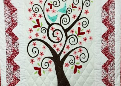 Pieces from My Heart – 35x43 – Multi colored – White/Red – Machine Quilted – Made by Marilyn Mortland – Ruthton, MN