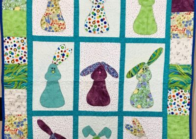 Bunny Patch – 36x53 – pieced & machine quilted – Multi colors – Made by Anonymous