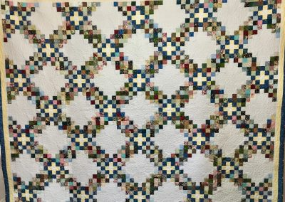 Triple Irish Chain – 81x101 – Pieced & Machine Quilted – Hand wash or spot clean or machine wash on delicate cycle – Multi colors – This quilt was one of Norma's last quilts made.