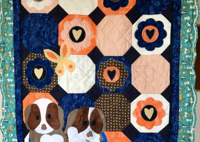Puppy Love – 38x50 – Pieced, Appliqued, Machine Quilted- Blues, Turquoise, brown, yellow & cream – Made by LaNan (Bliss) Eldrige – Primghar, Iowa