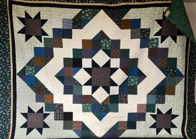Stars Over The Prairie – 92x115 – Pieced & Machined quilted – Blues & Tans Flannels – Made by Jean Weness – Worthington, MN