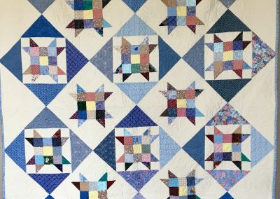 9 patch Star – 60x80 – Pieced & Machine Quilted – Blues & Calico – Made by Kathy Griffith – East Side Lutheran – Sioux Falls, SD