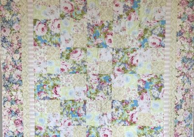 Pastel Flower Patch  - 57x66 – Pieced and Machine Quilted – pink/blue pastels – pieced by Ardith Palmer – Jackson MN – Made by Our Saviors –Jackson, MN