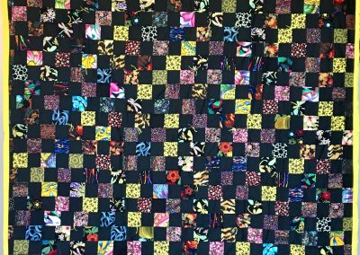 Bubble Bee Blocks – 60x78 – Pieced & Tied – Black, yellow & Multi colored Squares w/yellow back – Made by American Lutheran Quilters – Windom, MN