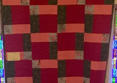 Pieced Machine quilted- pink, red, green – Made by Peggy Ludeman – Tracy, MN