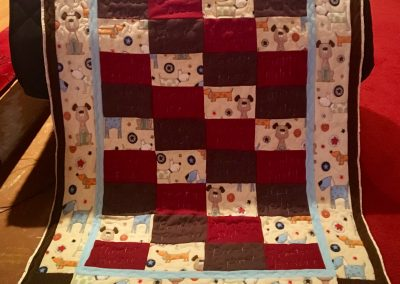 How much is that doggie in the window – 54x70 – Pieced & Machine quilted – multi colors – Made by Connie Anderson – Tracy, MN