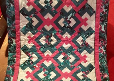 Lovers Knot – 80x58 – Pieced & Machine quilted – Shades of green and pink – Made by Tracy Lutheran quilters, quilted by Wendy Haney – Tracy, MN