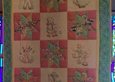 Mother Goose meets Vintage Stars – 42x35 - Pieced, Machine quilted & embroidery – multi green, red, yellow – Made by Peggy Ludeman & the late Mary Lou Ludeman – Tracy, MN
