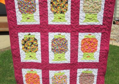 Candy Gumball Machine – 37x49 – Pieced & Machine Quilted – Multi w/pink borders – Made by Diane, Holly, Linda & Pat – Sioux Falls, SD