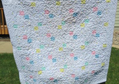 Pastel Hearts – 54x54 – Pieced & Machine Quilted – White background twisted 9 Patch pastels and heart prints – Made by Diane, Holly, Linda & Pat – Sioux Falls, SD