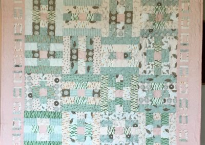 It's a Girl – 52x52 – Pieced & Machine Quilted – Pastel pink, green & white – Made by Diane, Holly, Linda and Pat – Sioux Falls, SD
