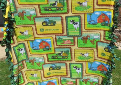 John Deer Green – 52x72 – Tied blanket – Green & Gold – Made by Pat, Linda & Holly – Sioux Falls, SD