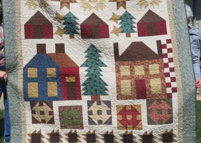 Nestled in the Woods – 91x77 – Pieced & Machine quilted – Earth tones, Thimbleberries Sampler – Made by Diane, Holly, Linda & Pat – Sioux Falls, SD
