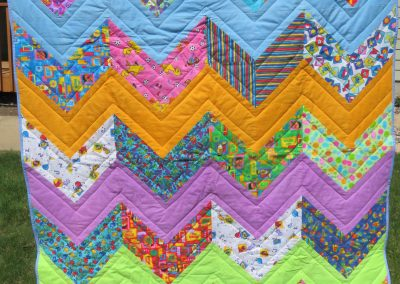 Visit Sesame Street – 56x70 – Pieced & Machine Quilted – Brights, Zig Zag pattern – Made By Diane, Holly, Linda & Pat – Sioux Falls, SD