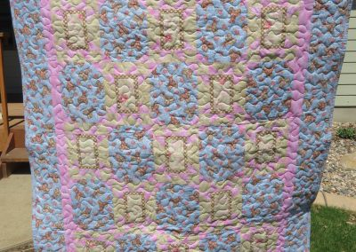 Bunny Love – 41x51 – Pieced & Machine Quilted – pink & blue bunnies w/star alt. blocks – Made by Diane, Holly, Linda & Pat – Sioux Falls, SD